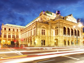 Vienna state opera at night with traffic
